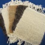 hand spun dog hair yarn woven mug rugs
