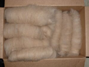 box of carded dog hair ready to spin